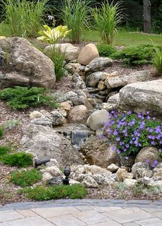 Front Yard Landscaping 50 Super Easy Dry Creek Landscaping Ideas You Can Make! - Images and ideas for backyard landscaping and do it yourself projects to easily create dry creek and river bed designs that dress up your property. Landscaping With Rocks, Front Yard Landscaping, Backyard Landscaping, Backyard Waterfalls, Dry Riverbed Landscaping, Backyard Ideas, Inexpensive Landscaping, Pool Ideas, Backyard Patio