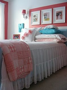 3 frames above bed in a painted 'frame'  LOVE the bed coverings too.