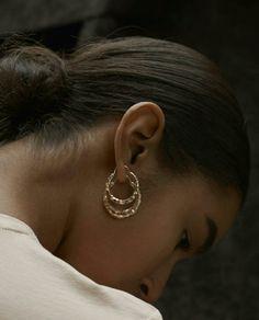 #hair #style #bun #earrings