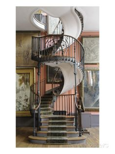 Spiral staircase designed by the architect Albert Lafon, on the second floor of Gustave Moreau's home, flanked by the artist's own paintings
