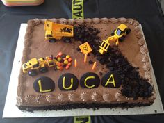 """Construction Cake.  Made this, but on a smaller scale since I did a 8"""" round.  Used a digger, crushed oreos and leaf shaped sprinkles.  Turned out cute and was so simple."""