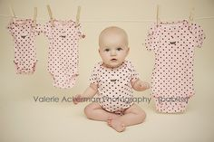 Buy the same onesie and do a 3, 6, 9, and 12 mos photo like this.