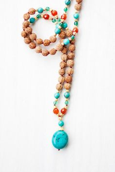 Bhakti Turquoise Mala made with rudruksha, gold, carnelian and agate.