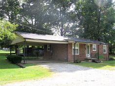 Cute 2 bedroom home that is move in ready. Has newer insulated windows and heat pump. Also has a detached 12x25 carport with concrete floor. Big lot, plenty of room for a garden. Close to town and shopping. Great starter home or for someone wanting to downsize in Huntingdon TN