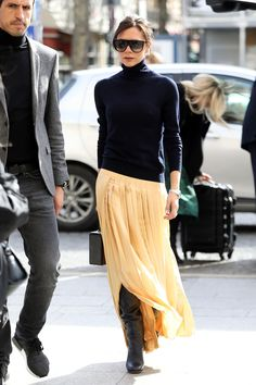 incorporating spring skirt with fine wool sweater<br> The English designer, Victoria Beckham, took a few cues with her Parisian wardrobe from her Spice Girls days. Mode Victoria Beckham, Victoria Beckham Outfits, Victoria Beckham Fashion, Fashion Mode, Love Fashion, Fashion Trends, French Fashion, Daily Fashion, Paris Fashion