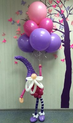 Cute dwarf balloon sculpture holding a bunch of balloons!