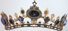 The Devonshire Intaglio Parure was commissioned by the 6th Duke of Devonshire for Countess Granville – the wife of his nephew – to wear in Moscow at the coronation of Tsar Alexander II in 1856. It consists of seven pieces of jewellery – a bracelet, bandeau, comb, coronet, stomacher, necklace and diadem – all of which are set with a major part of the 2nd Duke of Devonshire's collection of eighty-eight cameos and intaglios.