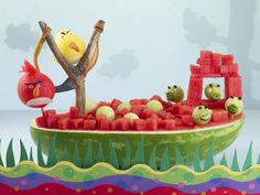Turn a watermelon into an Angry Birds centerpiece with directions at www.watermelon.org.
