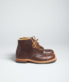 The Johnson was one of the best boots last season from Yuketen. This season we greet its cousin, the Johnny boot. Essentially the same upper, but with a more classic heel structure.    - Made from fine quality chrome excel leather  - Leather laces  - Toe cap with brogue detailing  - Cats Paw Sole  - Made in Canada  - Fits true to size