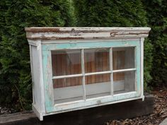I repurposed this great old window into a fun cabinet, complete with some old chippy painted trim boards and vintage bead-board and antique crystal knob.  https://www.facebook.com/Carlasgardenanddecor