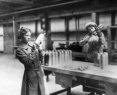 Women workers assembling artillery shells at a Vickers munitions factory, during the first world war.