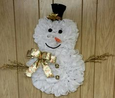 One of my most popular wreaths Full Snowman-Deco Mesh wreath, with battery operated lights. Perfect home decoration to live on all winter long.  Decorate your door, window, wall, etc. Comes with battery operated lights and your choice of color for the ribbon.  #decomesh #wreath #snowman #winter #Christmas #gift #homedeco