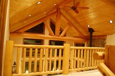 Log railings and log trusses by Mountain Log Homes, www.MtLogHomes.com and www.TheLogDepot.com
