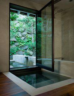 Indoor/Outdoor Pool with a Wood Casement Window,