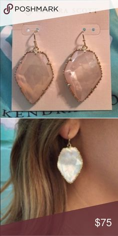 "Kendra Scott Corley Drop Earrings in Ivory Pearl Kendra Scott's classic Corley earrings pair an elegant geometric silhouette with the timeless allure of ivory mother of pearl, for a subtle glamour you cannot resist. 14K Gold Plated Over Brass. Size is 1.31""L x 1""W on earwire. Material is ivory mother-of-pearl. Please note that due to the one-of-a-kind nature of the medium, exact color patterns may vary slightly from the image shown. Comes with Kendra Scott jewelry bag. Kendra Scott Jewelry…"