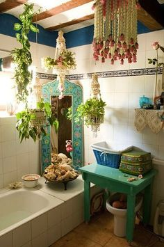 i like the idea of hanging plants in the bathroom i like this space but there is a baby doll in the toilet.... Lol