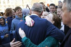 Hugs: schoolgirls ask for and receive a hug from Prince Charles after his visit to the National Archives in Washington