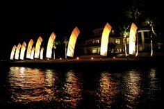 Wedding Feather Banners at night lighted with professional LED lighting Unique Weddings, Outdoor Weddings, Industrial Wedding, Wedding Vendors, Night Light, Banners, Feather, Building, Wedding Fun