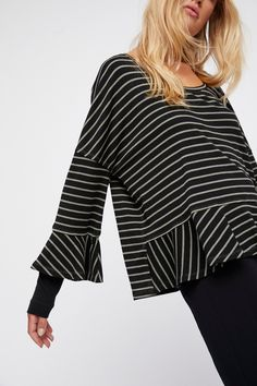 We The Free Round About Tee | Easy and effortless ribbed tee featuring ruffle trim along the hem and sleeve cuffs.  * Solid layering detail on the sleeves * Rounded neck * Striped print