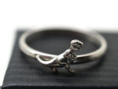 Hey, I found this really awesome Etsy listing at https://www.etsy.com/listing/218170938/tyrannosaurus-rex-ring-silver-dinosaur