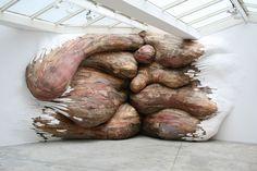 Scrap wood installation by Henrique Oliveira