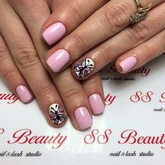 Pink and white themed butterfly nail art design. A wonderful pastel inspired design where the butterfly is multi-colored in contrast to the plain white background in order for it to stand out and look unique.