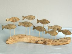 Hey, I found this really awesome Etsy listing at http://www.etsy.com/listing/160390413/driftwood-fish-shoal-ornament