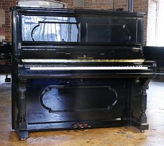 An 1892, Steinway upright piano with black case at Besbrode Pianos. Beautiful antique case styling.  £10,000