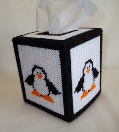Happy little penguin boutique-style tissue box cover, stitched on 7-mesh plastic canvas. Made with acrylic yarn with black fabric painted eyes. Cute decoration for wintertime and the Christmas season. Tissues NOT included.
