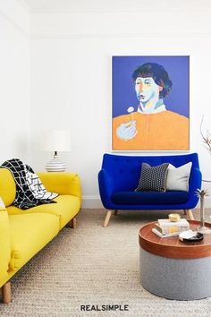 30 Easy and Chic Living Room Decorating Ideas for Any Sized Space | Don't be afraid to go bold with an eye-catching piece of art that feels less formal than a framed version. It makes this whole living room from Banner Day Interiors feel a bit brighter, more fun, and a little less formal. #realsimple #livingroomdecor #livingroomideas #details #homedecorinspo