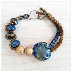 Blue lampwork bracelet  blue and bronze by UtterlyLovelyStuff