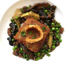 Pork belly with chorizo, artichoke hearts, mushrooms and peas