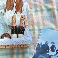 The Champagne Picnic includes 2 demi-baguettes, soft cheeses, fig preserves & apples, 2 mini Moet bottles of champagne and 2 champagne glasses all tucked in a lined whicker basket for $175