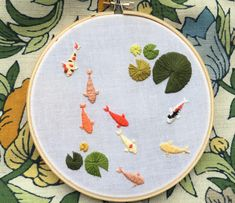 Koi pond, embroidery.  ...Wonder if translating a traditional Japanese koi (or crane!) painting to stitchery would work...  Ideas