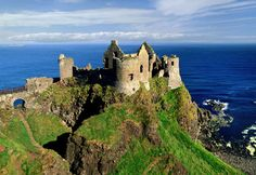 You can't swing a fiddle without hitting a stone castle — or the ruins of one — in Ireland. Dunluce Castle stands out for its dramatic setting high on a headland near Bushmills in County Antrim.