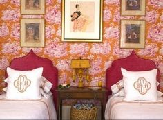 Hot pink headboards against a hot-colored toile (is that orange or a deep gold?).
