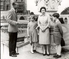The Queen and the Duke of Edinburgh with their children, the Prince of Wales and Princess Anne, who says that growing up in Buckingham Palace was lonely at times