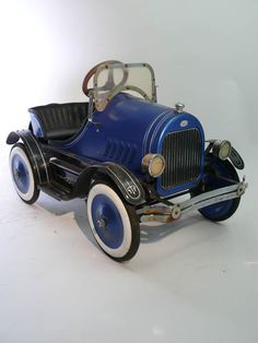 Vintage toy peddle car, blue with black seat and mud guards, 103cm long. #Vintage #toy. **Available to hire.** (Stock code;- PGTG10264)