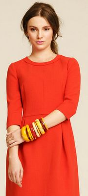 I love the color of this dress!  I might need this! :)