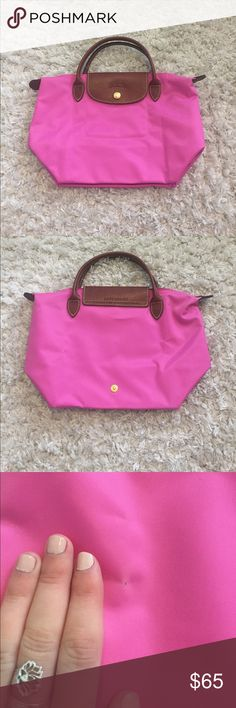 """MINI LE PLIAGE LONGCHAMP BAG Mini pink Longchamp bag in color BUBBLE. Never been used. Perfect condition except for one mark on the back (pictured in pictures 2 and 3).  MEASUREMENTS - 8.25""""W x 5.5""""D x 8.25""""H - 3"""" handle drop Longchamp Bags"""