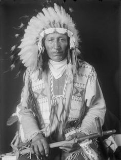 Anapao Wa-Ku-Wa (Chase in the Morning or at Dawn), Dakota Oglala, Called Stanley, in Native Dress with Headdress, Holding Pipe - Gill - FEB 1909