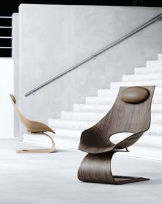 """""""Famed Japanese architect Tadao Ando partnered with Carl Hansen  Søn to design a sculptural lounge chair that pays tribute to Hans J. Wegner. The Dream Chair combines Danish craftsmanship with traditional Japanese design and is meant to encourage people to spend more time dreaming."""""""