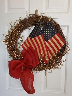 Patriotic Wreath with Tea Stained Flag with an abundance of golden sprigs placed on a 18 inch grapevine wreath. A beautiful Red Burlap bow and a tea-stained American flag add a true Patriotic feel to this Patriotic Treasure. Memorial Day Decorations, Memorial Day Wreaths, 4th Of July Decorations, Grave Decorations, Holiday Decorations, Deco Mesh Wreaths, Holiday Wreaths, Door Wreaths, Ribbon Wreaths