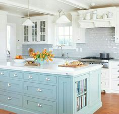 White kitchen cabinets, with a different color island.