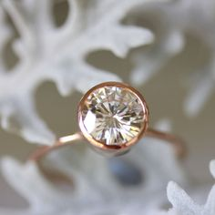 7.5mm Moissanite Engagement Ring In 14K Rose Gold - Made To Order. $1,180.00, via Etsy.