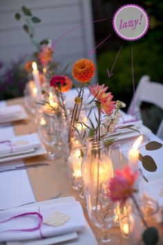 This is for a table setup, but I like the single-flower-in-old-glass-jars/vases idea. Maybe for the stage at the Avon?