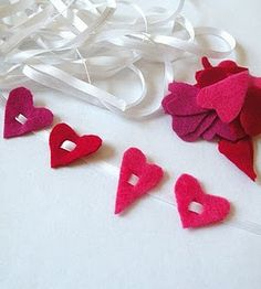 """We could cut larger hearts and use larger ribbon to make 3-5 hearts into a """"table runner."""" Maybe alternate them so they face both directions.?"""