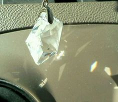 I have a star pendant that hangs off of my rearview mirror. When sunlight shines on it it's like I'm in a disco ball~