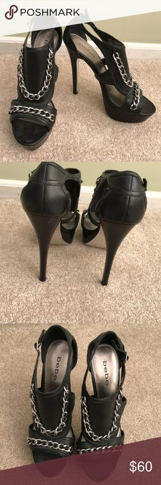 """bebe Stiletto Platform Heels Silver Chains, Sz7 Gorgeous, sexy bebe shoes! They are black with the silver chains. Stilettos, platforms. These are a size 7 and are in excellent condition. They were worn once for a fashion show. The heel is 5 1/2"""" high. With a 1 1/4"""" platform. bebe Shoes Heels"""