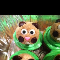 Groundhog cupcakes, a cupcake w green icing and a groundhog cake pop to top it off.